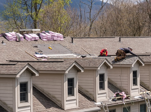 Champaign Roofing Companies repairing a roof