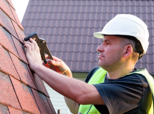Close up of a Man Repairing Roofing near Champaign